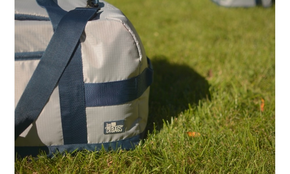 Silver Spinnaker Cruiser Duffel close up on grass