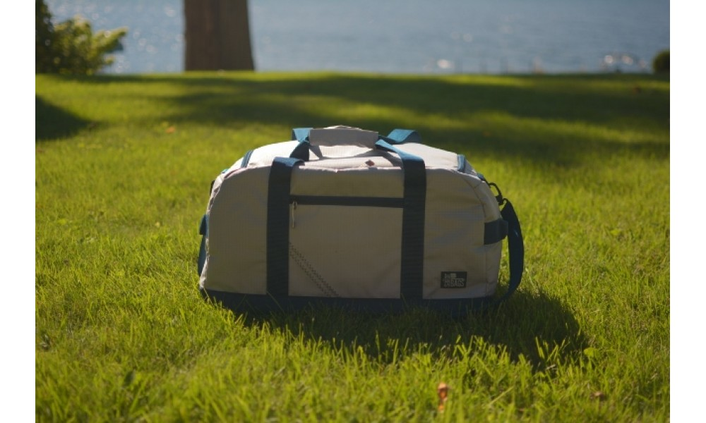 Silver Spinnaker Racer Duffel on lawn