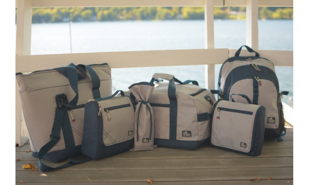 Silver Spinnaker Cooler Tote  with complete set overlooking lake