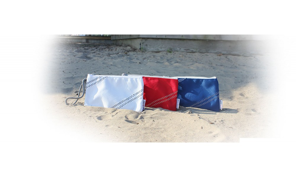 white red nautical blue wristlets sitting in sand together