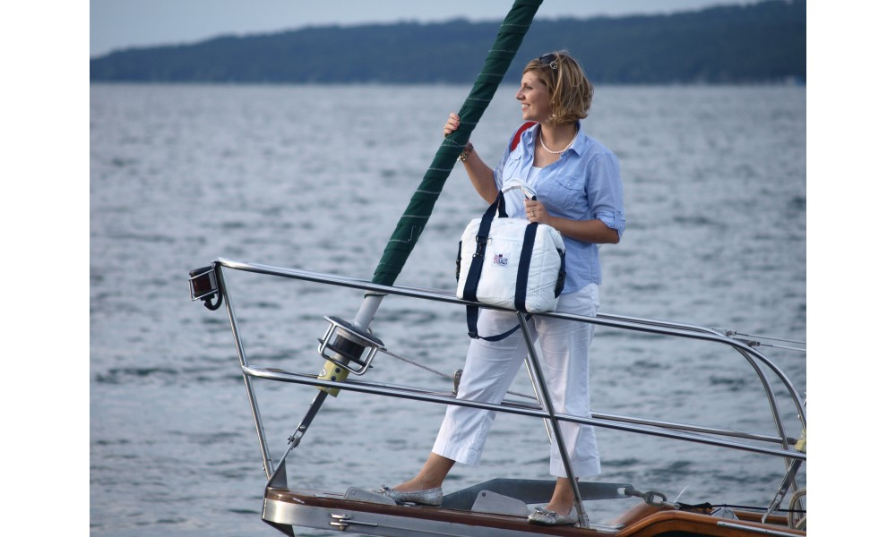 Newport Cooler Bag - 12 Pack woman standing on bow of boat