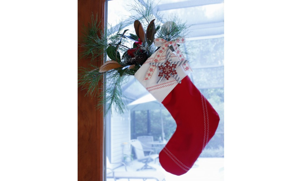 red sailcloth stocking hanging in window