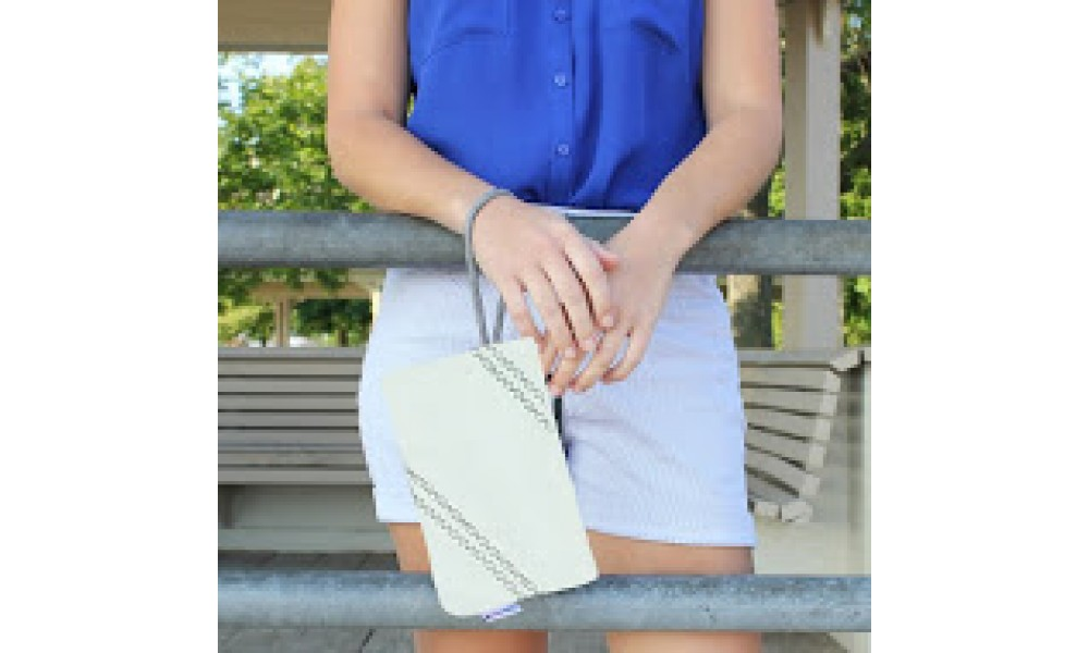 close up of white chesapeake wristlet