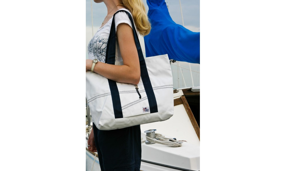 black and white tote carried over shoulder
